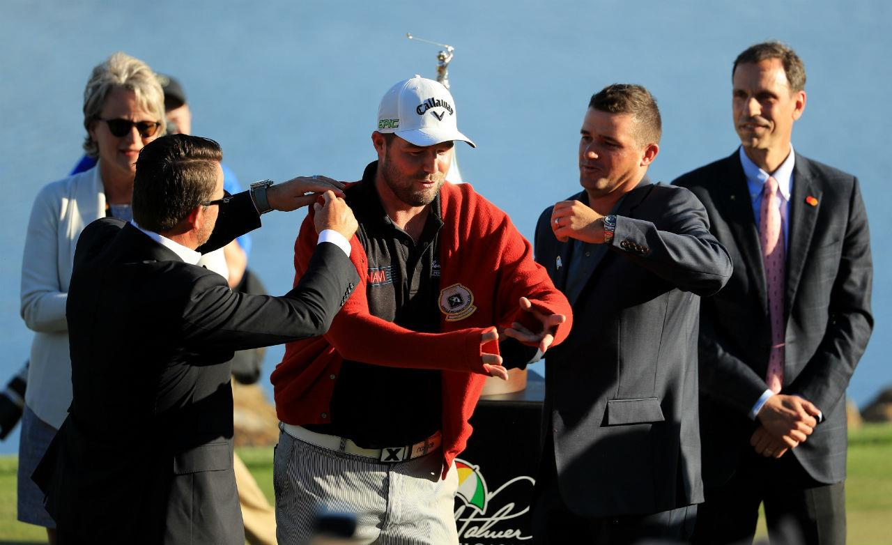 Marc Leishman presented with Arnold Palmer red cardigan